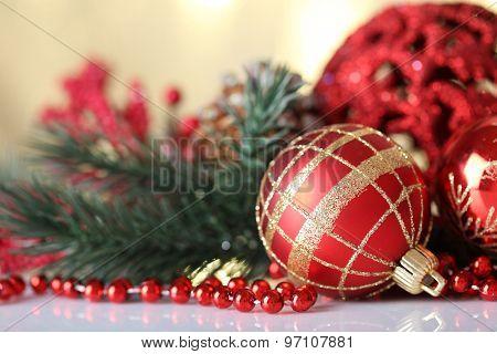 Beautiful Christmas balls on light blurred background