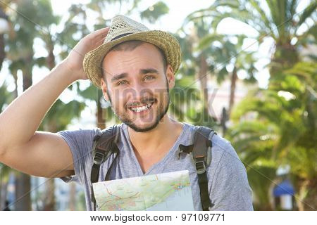 Happy Guy On Vacation With Bag And Hat Holding Map