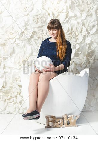 Beautiful Pregnant Woman Posing With Big Egg At Studio