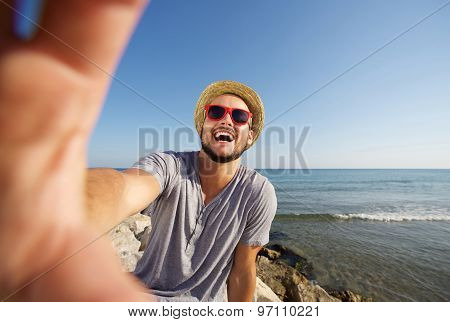 Man On Vacation Laughing At The Beach Taking Selfie
