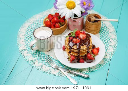 Stack of pancakes on wooden background