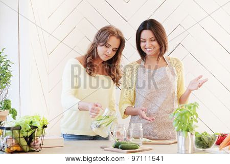 Cooking. Two girls in the kitchen