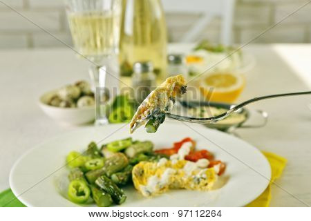 Roasted asparagus with fried egg on plate on table background