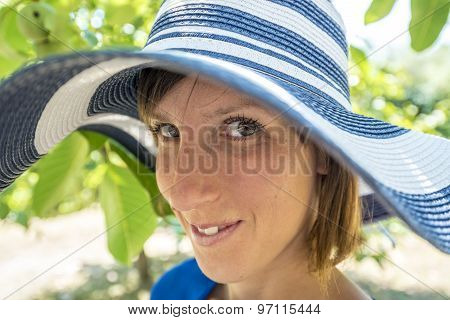 Pretty Friendly Woman In A Stylish Hat