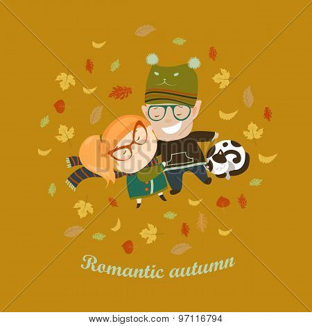 Romantic couple lying on grass among the fallen leaves