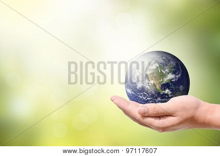 Male Hand Holding The Earth