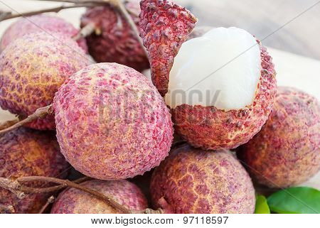 Closeup of lychee fruits on wooden board, fruits of asian