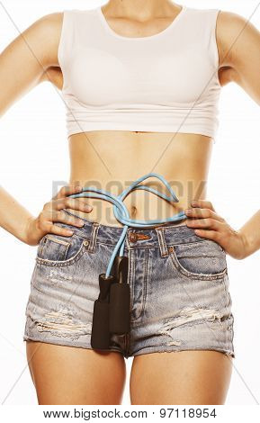 young pretty woman with skipping rope isolated on white