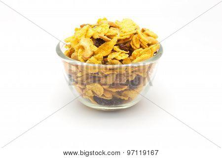 Bowl of honey caramel cornflakes isolated on white