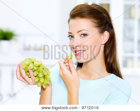 Beautiful Woman Eating  Grapes