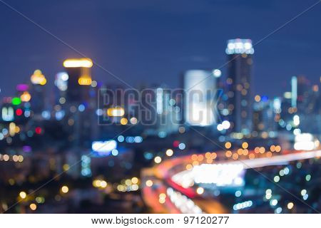 Abstract blurred bokeh of city downtown at night