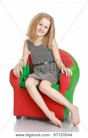 Beautiful girl on the chair