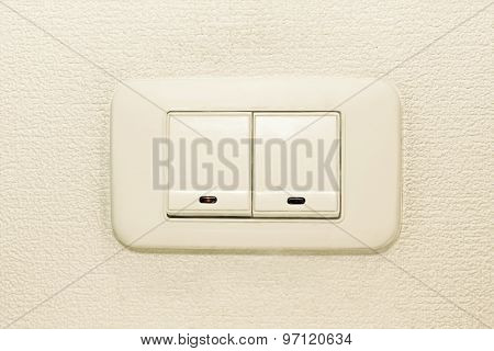 Light Switch On Beige Wall Background.