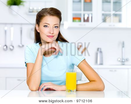 Woman With A Glass Of Fresh Orange Juice