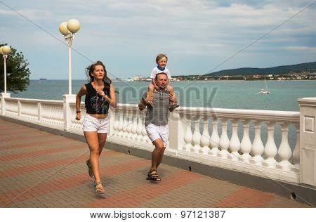 Young Family Small Son Jog Along Promenade Sea