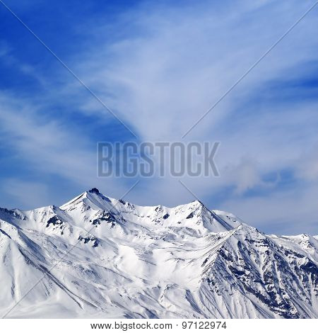 Winter Snowy Mountains At Sun Windy Day