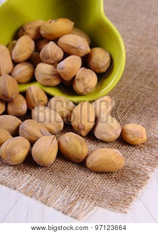Pistachio Nuts In Bowl On White Wooden Table, Healthy Eating