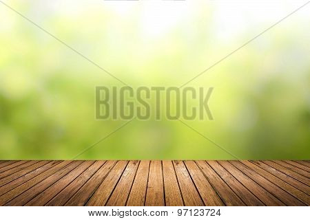 Wooden Floor With Green Nature Blurred Background
