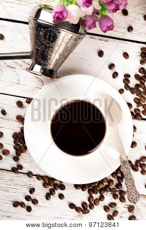 Cup Of Coffee And Scattered Coffee