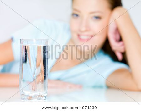 Smiling Woman  With  Waters Glass