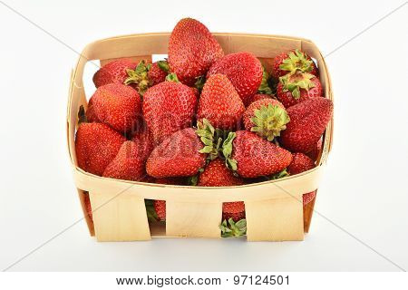 Mellow Strawberries In Wooden Basket Isolated On White