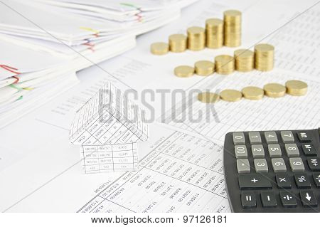 House And Calculator With Group Step Pile Of Gold Coins