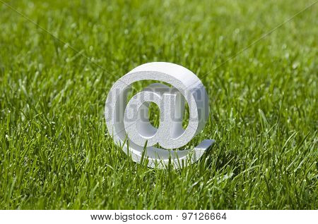 Email sign on green grass