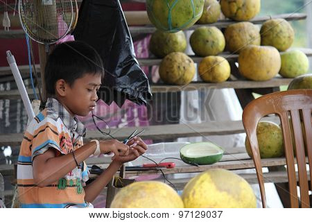 Young Indonesian Boy At Work