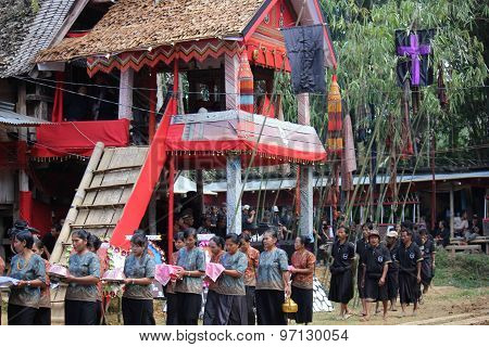 People Procession At A Funeral Ceremony In Indonesia