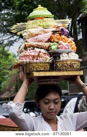 Balinese Woman Carrying Food On Her Head