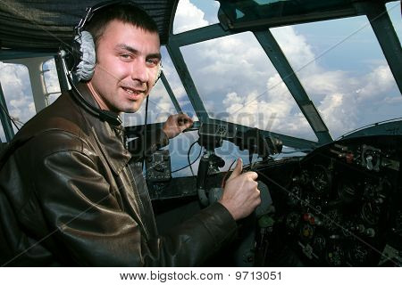 Young Pilot In Booth Of The Airplane