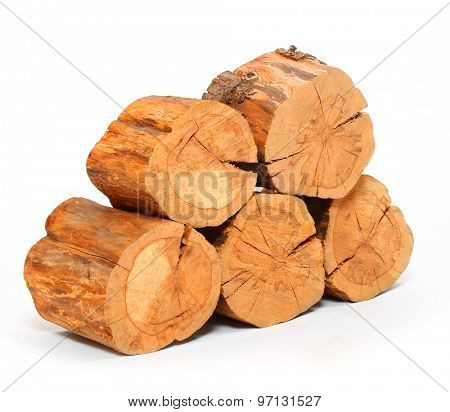 Stack of firewood isolated on white background. Renewable energy from forest.