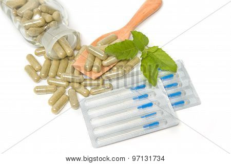 Herbal Drug Capsules In Wooden Spoon With Acupuncture Needles ,alternative Medicine Concept.