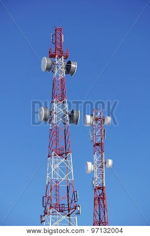 Towers Of Mobile Operators On A Background Of Blue Sky