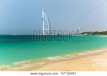 DUBAI, UAE - 2 APRIL 2014: Jumeirah Beach and Burj Al Arab hotel in Dubai, UAE. Jumeirah Beach is a white sand beach that is located and named after the Jumeirah district of Dubai.