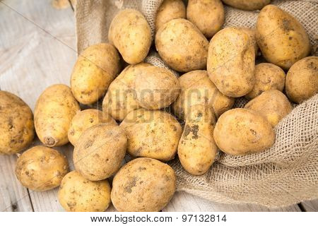 Potatoes spilling out of sack
