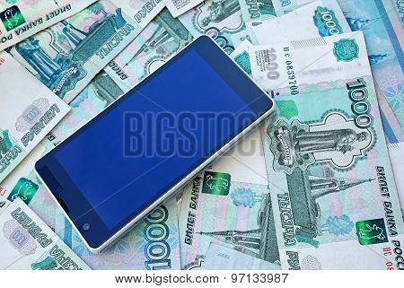 Mobile phone smartphone and money on Russian banknotes