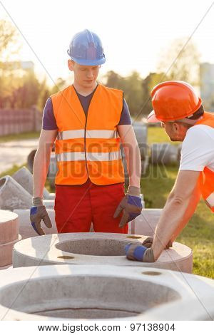 Builders And Concrete Pipes