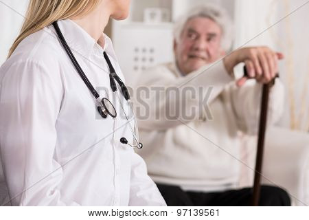 Doctor Diagnosing Disabled Man