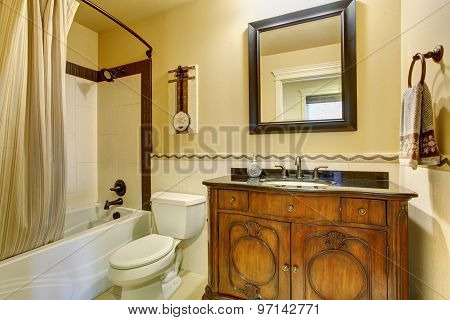 Authentic Style Bathroom With Stripped Shower Curtain.