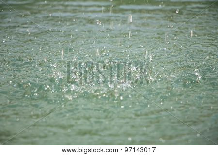 Photo small drops on surface of water