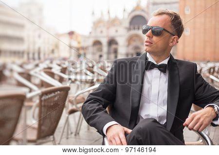 Portrait of handsome confident man in tuxedo