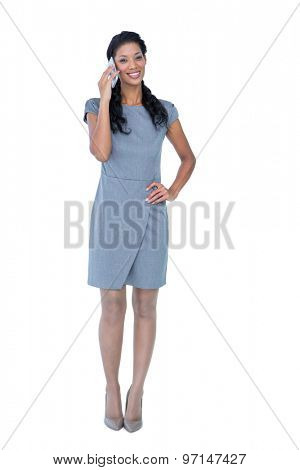 Happy businesswoman having phone call on white background