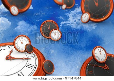 Clocks against painted sky