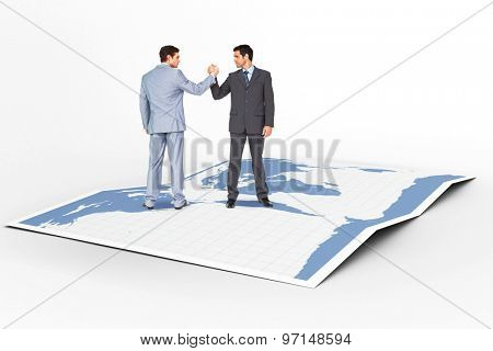 Businessmen shaking hands against world map