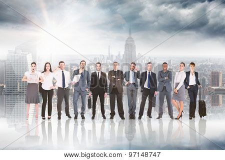 Business team against room with large window looking on city