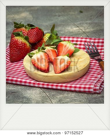 Instant Photo Of Strawberries On Wooden Plate
