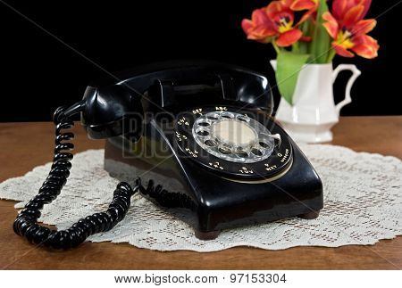 retro rotary dial telephone with tulips