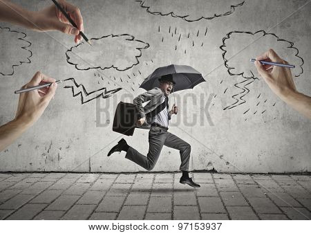 Running manager holding an umbrella