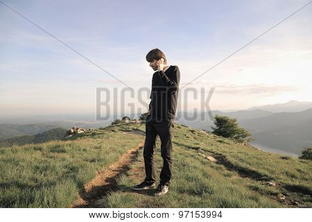 Man doing a phone call in the mountains